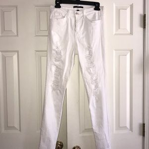 high-rise white ripped jeans